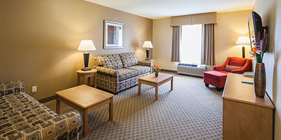 Suite with separate bedroom 1 king size bed, with 2queen sofa beds in living room with a kitchenette.